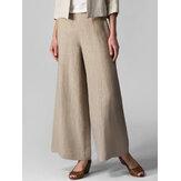 Damskie spodnie z szerokimi nogawkami i kieszenią