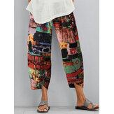 Bloemenprint Elastische taille Losse split Onregelmatige zoom Pocket Vintage broek voor dames