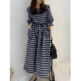 Vestido feminino com estampa xadrez com cordão na cintura e bolsos duplos manga comprida maxi