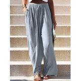 Damskie spodnie w jednolitym kolorze z elastyczną kieszenią i luźnymi nogawkami