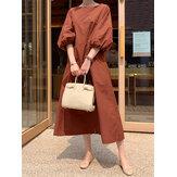 Vestido feminino de cor sólida com decote redondo e mangas bufantes.