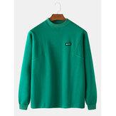 Camiseta de algodão cor sólida para homem com gola redonda e manga comprida.