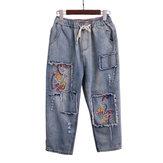 Vintage geborduurde denim jeans met elastische taille
