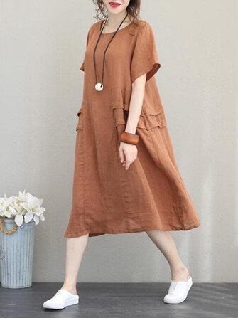 レトロな女性のカジュアルコットンソリッドカラー緩い半袖ドレス