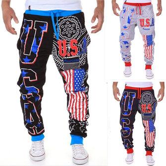 पुरुषों के फैशन लेस-अप स्पोर्ट्स जॉगर्स पैंट यूएसए फ्लैग प्रिंटिंग बीम फीट हैरम पैंट